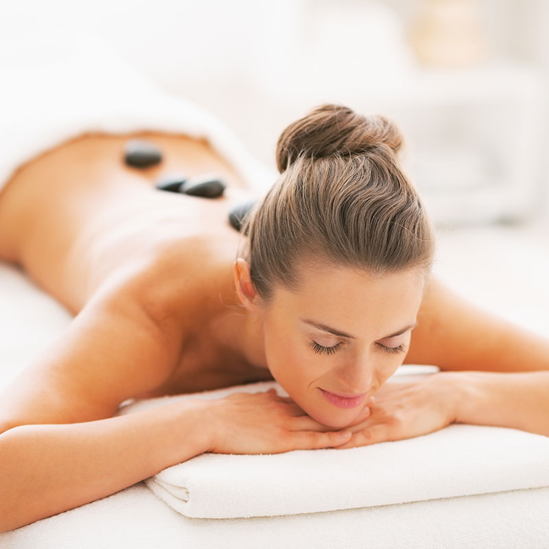 hot stone massage relaxes muscles and eases stress